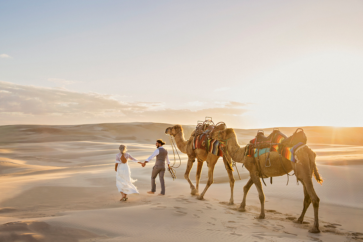styled-shoot-white-white-weddings-bohemian-desert-style-elopement-tips-camels-sand-dunes-sunset
