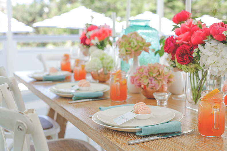 styled-shoot-watsons-bay-sydney-summer-wedding-styling-white-white-weddings-and-events-tablescapes-hampton-chairs-white-colourful-blue-napkins-grapefruit-cocktails-macaron-favours