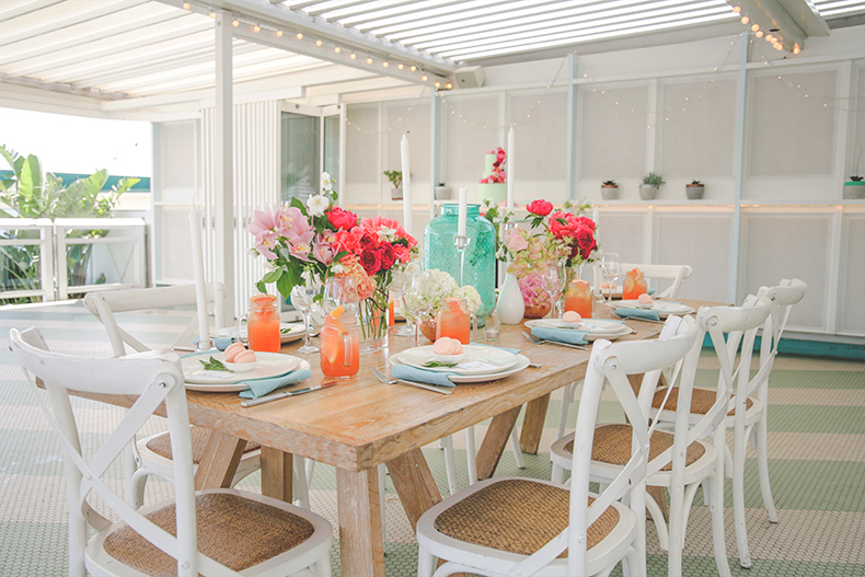 styled-shoot-watsons-bay-sydney-summer-wedding-styling-white-white-weddings-and-events-tablescapes-hampton-chairs-white-colourful-timber-table-deck-outdoor-tropical