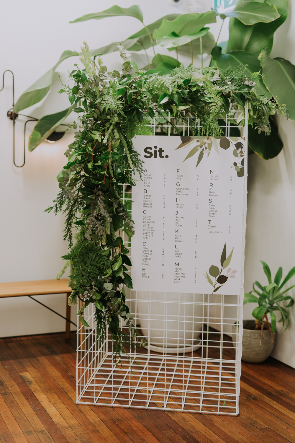 white+white weddings and events carrie and jay real wedding styling seating chart greenery