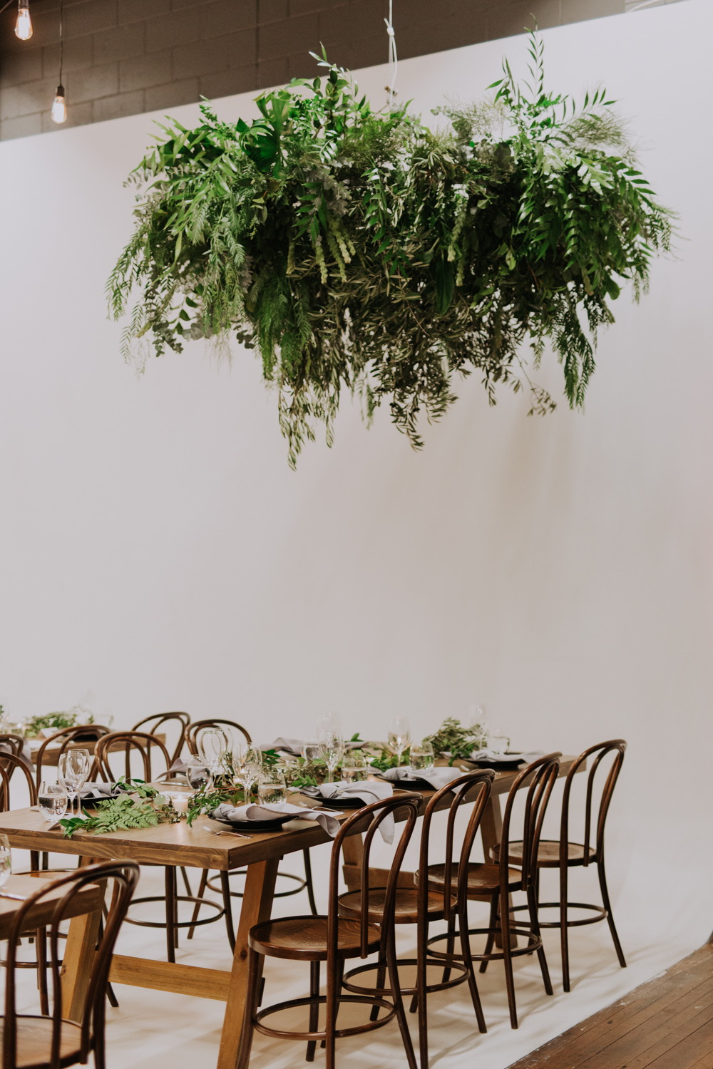 white+white weddings and events carrie and jay real wedding styling bentwood chairs banquet tables timber rustic studio warehouse venue greenery