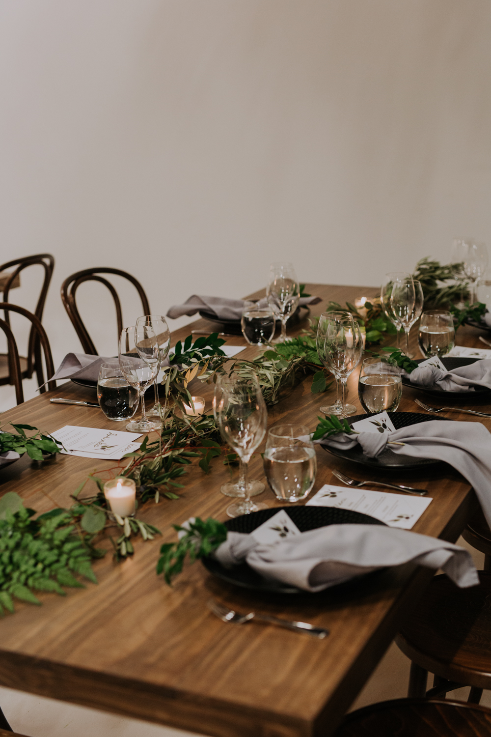 white+white weddings and events carrie and jay real wedding styling bentwood chairs banquet tables timber rustic studio warehouse venue greenery foliage