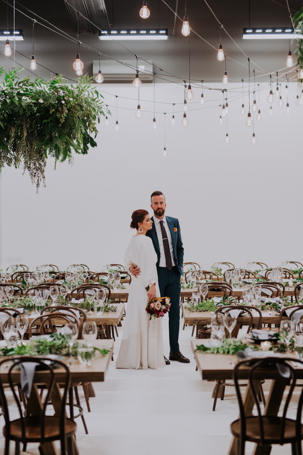 white+white weddings and events carrie and jay real wedding styling timber rustic studio warehouse venue bentwood chairs couple married bulb lighting