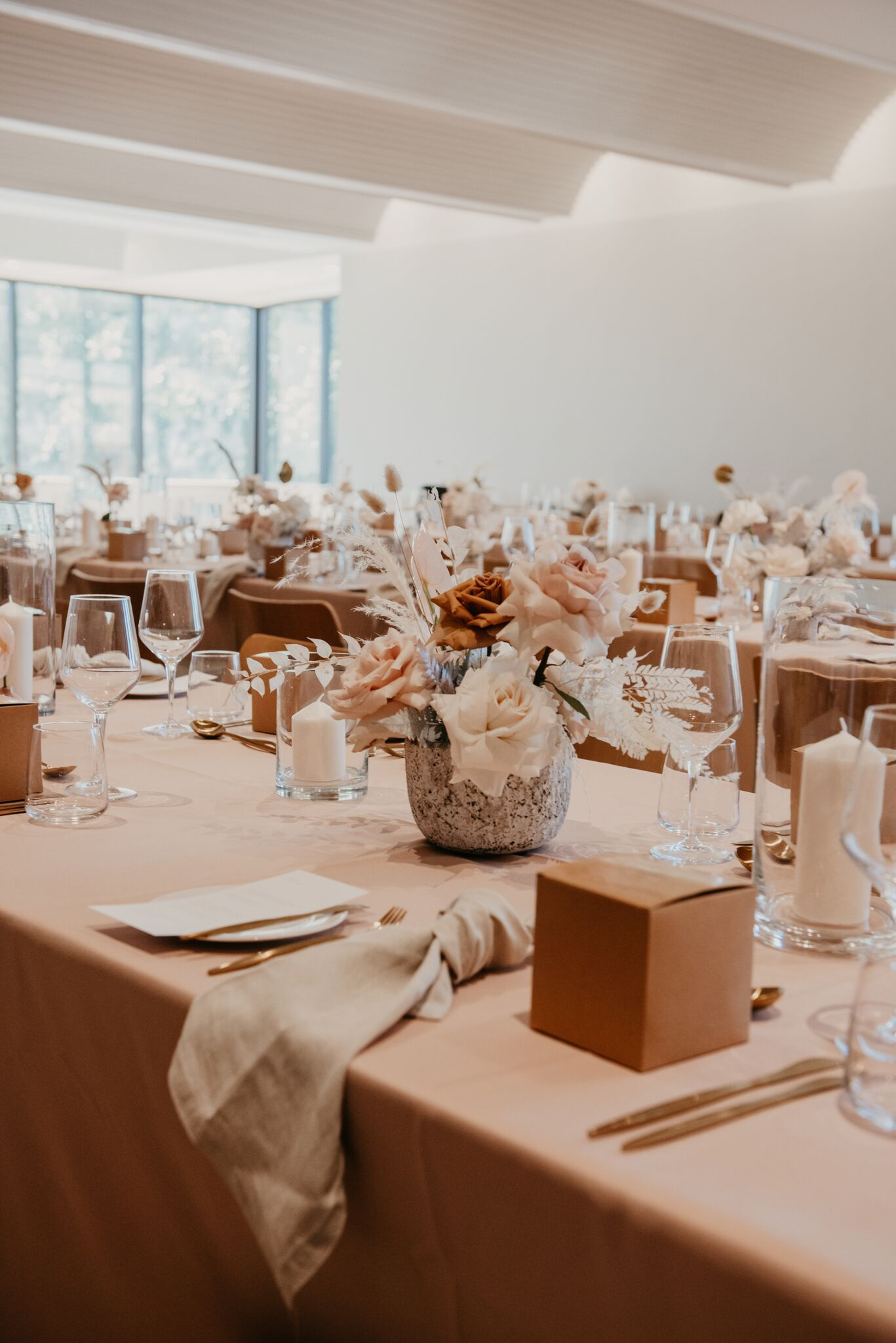 white+white the wedding school Yasmyn and Lincoln The Calile Hotel dusty pink cream florals linens reception venue tables close