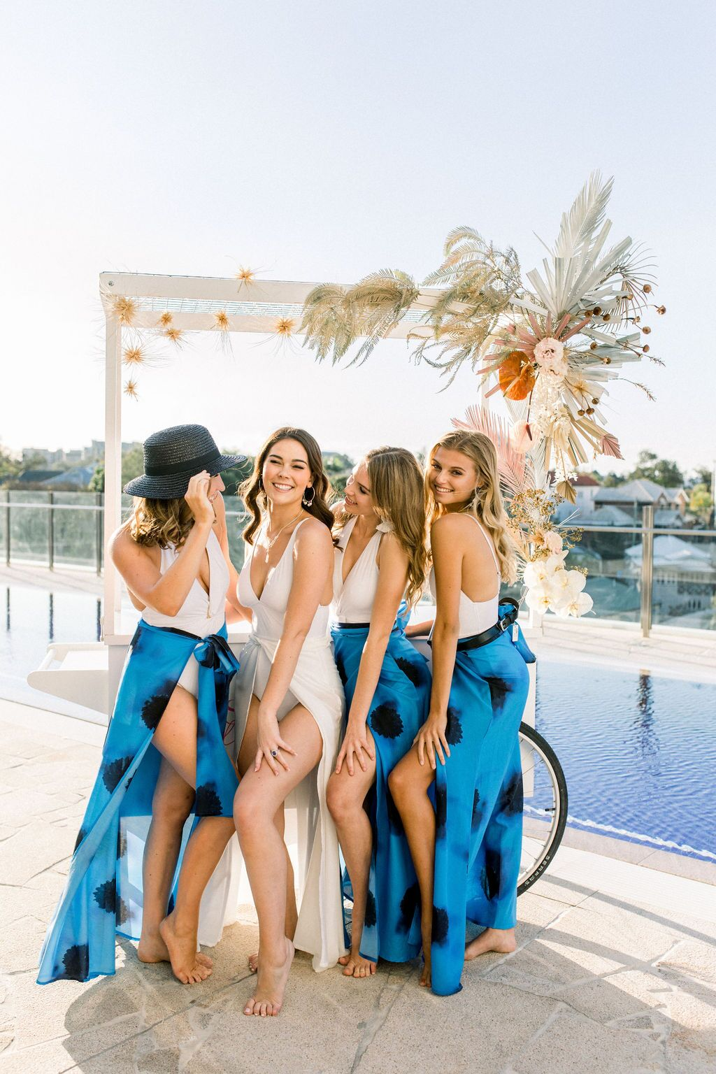 styled shoot white+white weddings and events get robed modern pink blue and white cart fun smiling