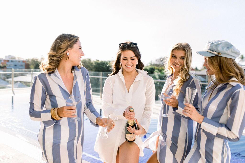 styled shoot white+white weddings and events get robed modern pink blue and white champagne
