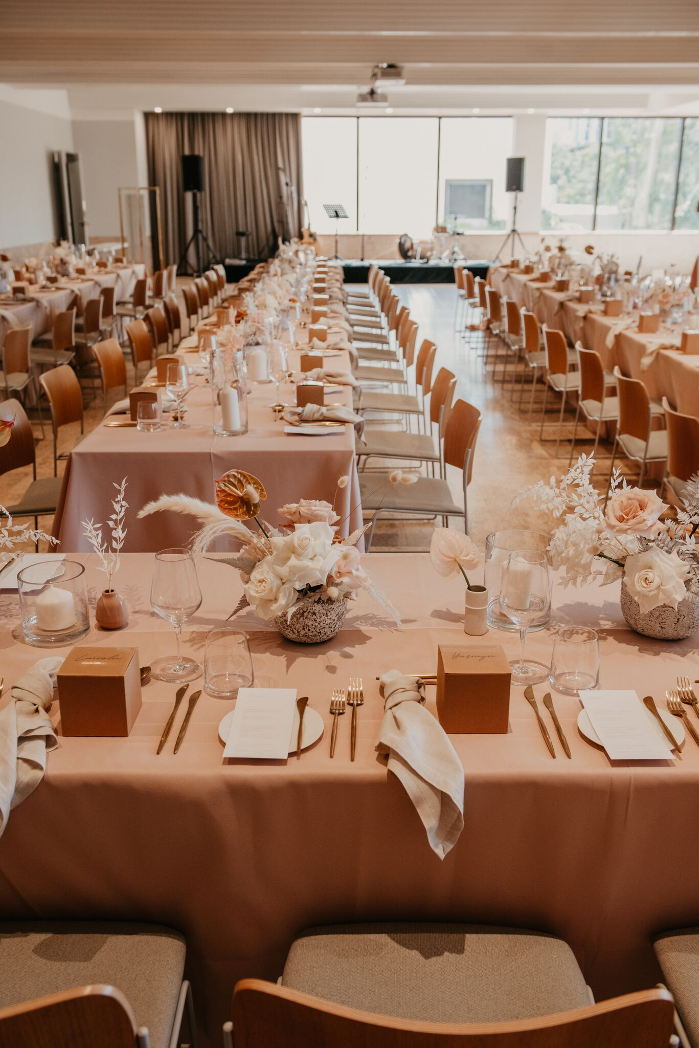 white+white the wedding school Yasmyn and Lincoln The Calile Hotel dusty pink cream florals linens reception venue tables close personalised styling dried florals gold cutlery bridal table
