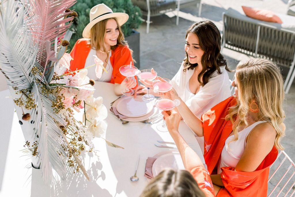 styled shoot white+white weddings and events get robed modern pink blue and white orange cheers