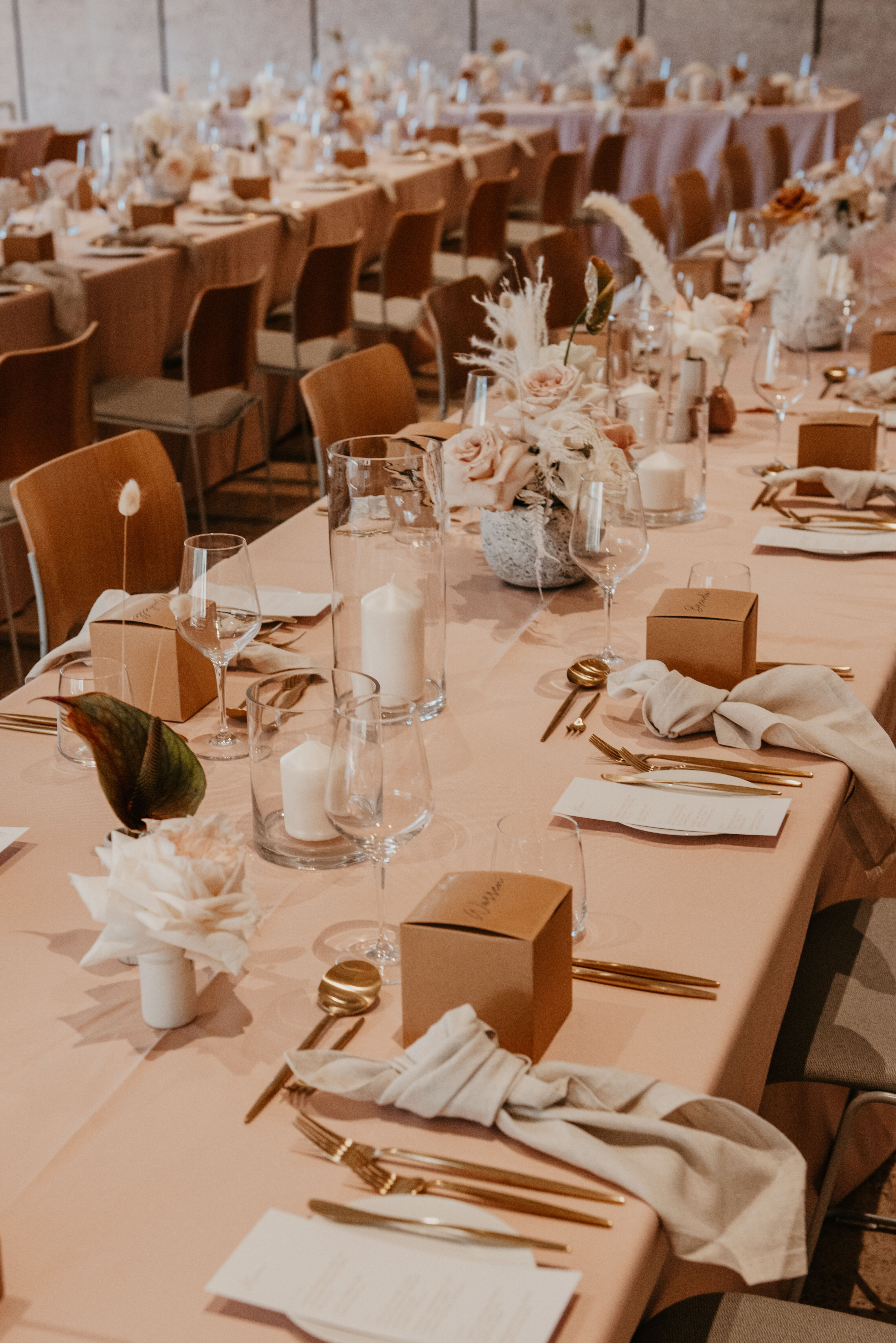 white+white the wedding school Yasmyn and Lincoln The Calile Hotel dusty pink cream florals linens reception venue tables close personalised styling