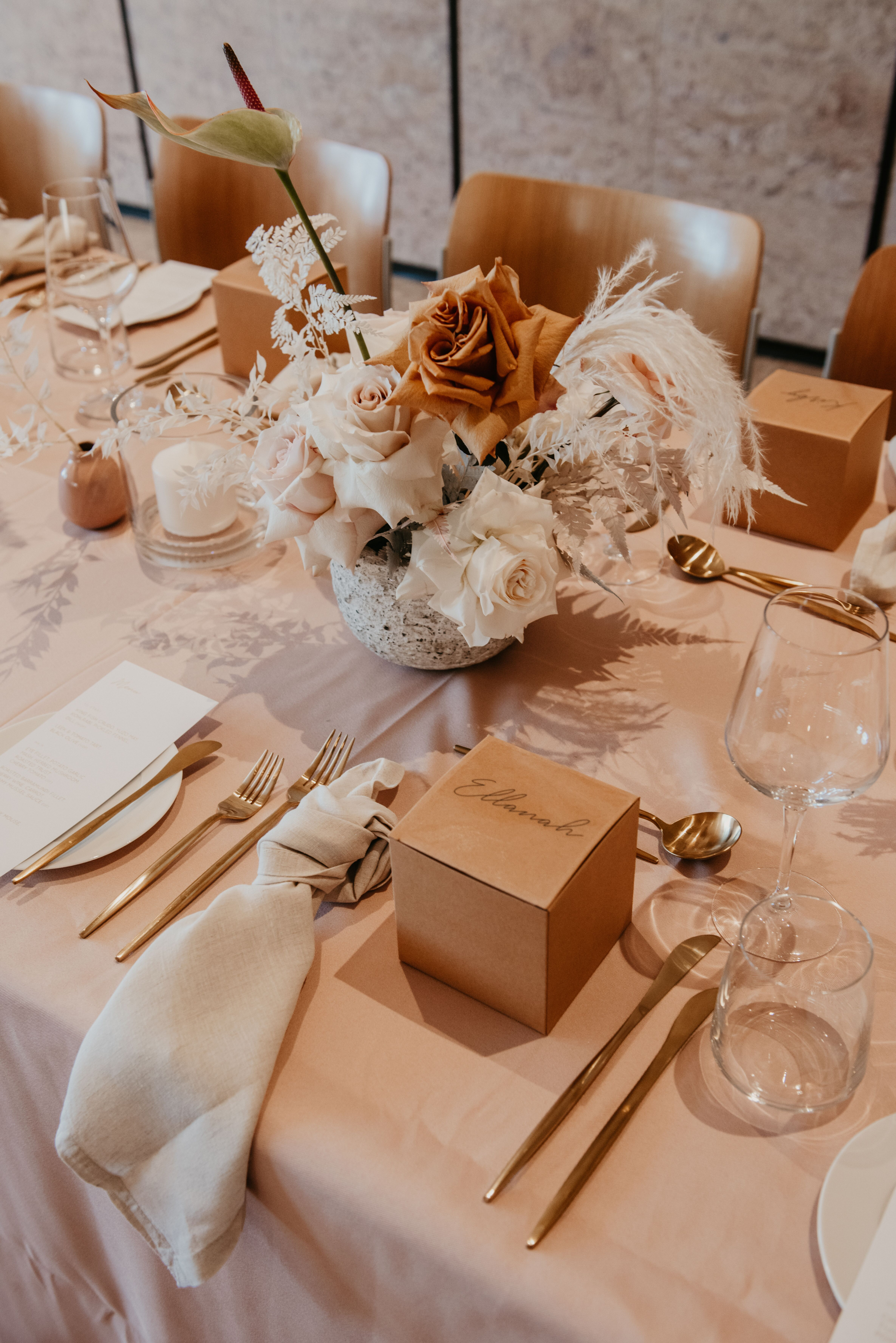 white+white the wedding school Yasmyn and Lincoln The Calile Hotel dusty pink cream florals linens reception venue tables close personalised styling dried florals gold cutlery
