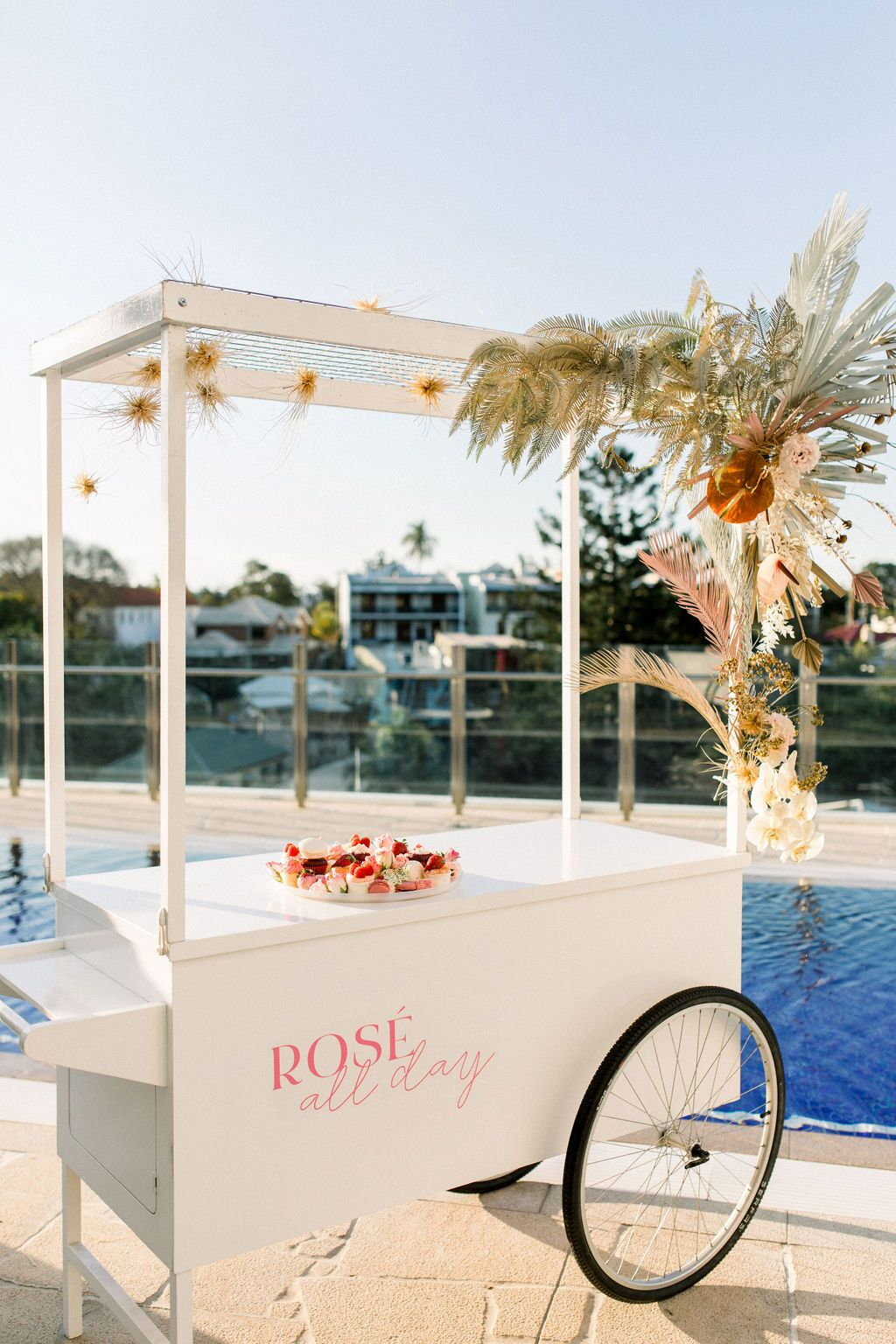styled shoot white+white weddings and events get robed modern pink blue and white cart