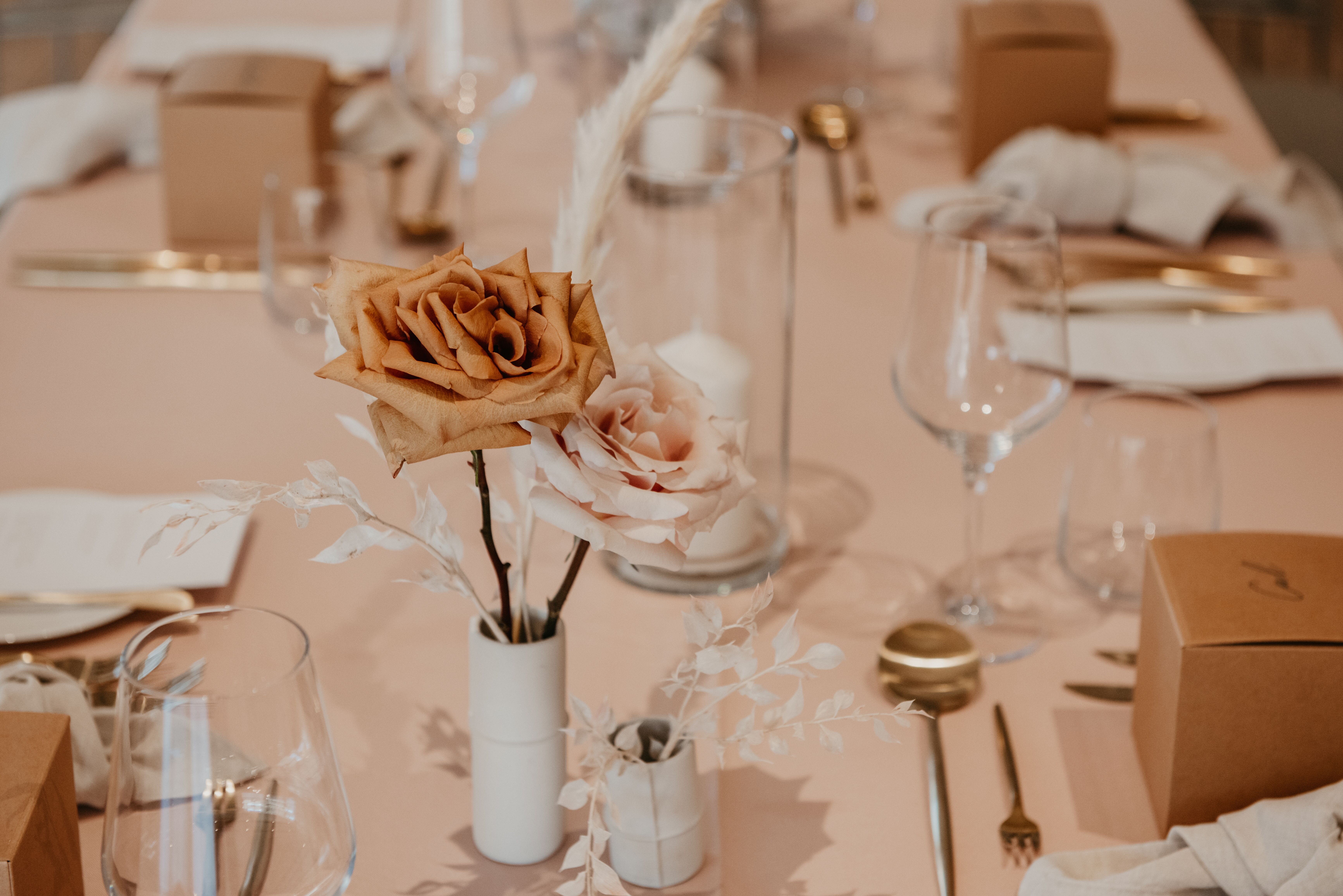 white+white the wedding school Yasmyn and Lincoln The Calile Hotel dusty pink cream florals linens reception venue tables close personalised styling dried florals