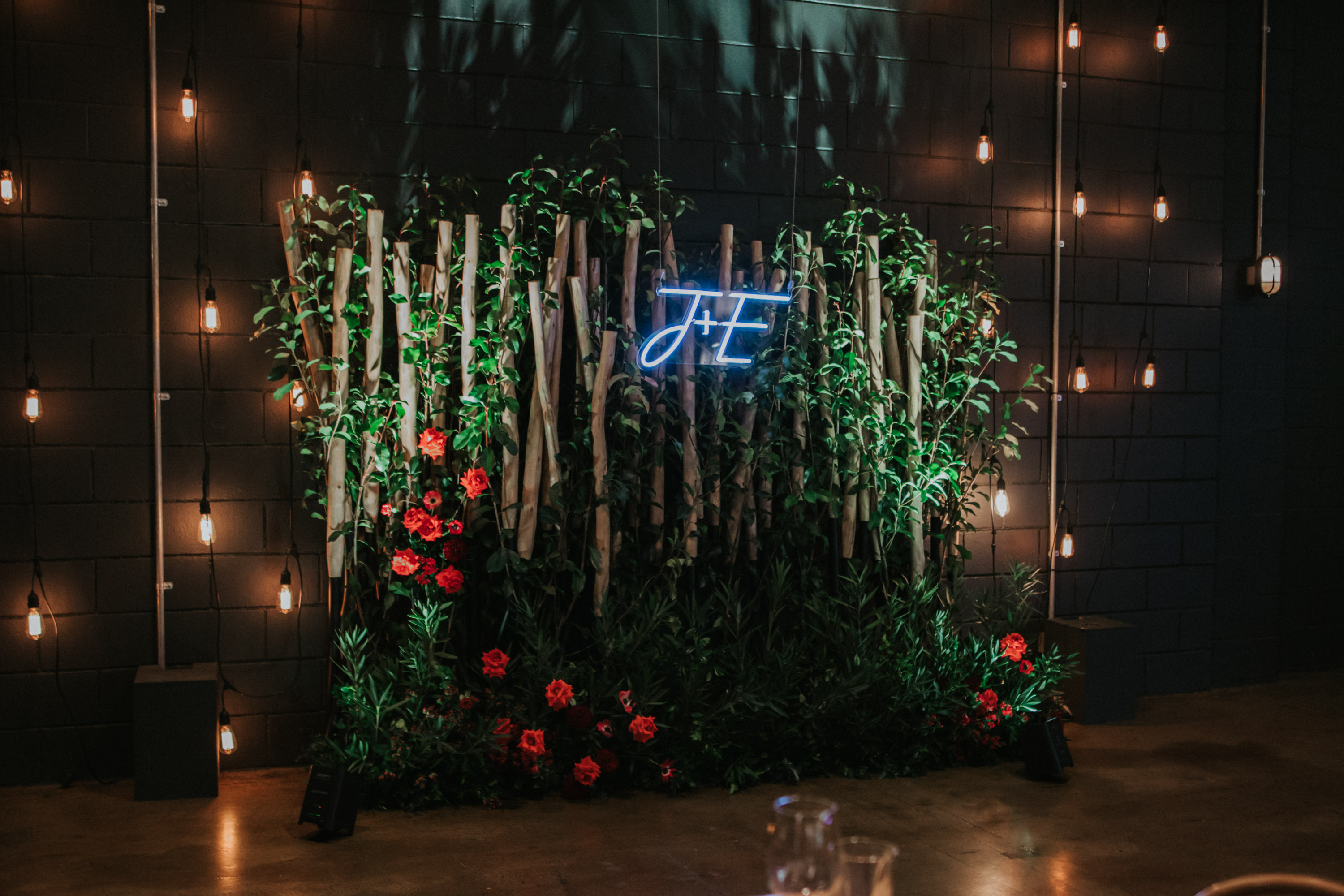 white+white weddings and events the wedding school emily and jack lightspace wedding greenery ceremony florals suspended hanging bentwood chairs asha reception table table number whole room long tableware neon sign