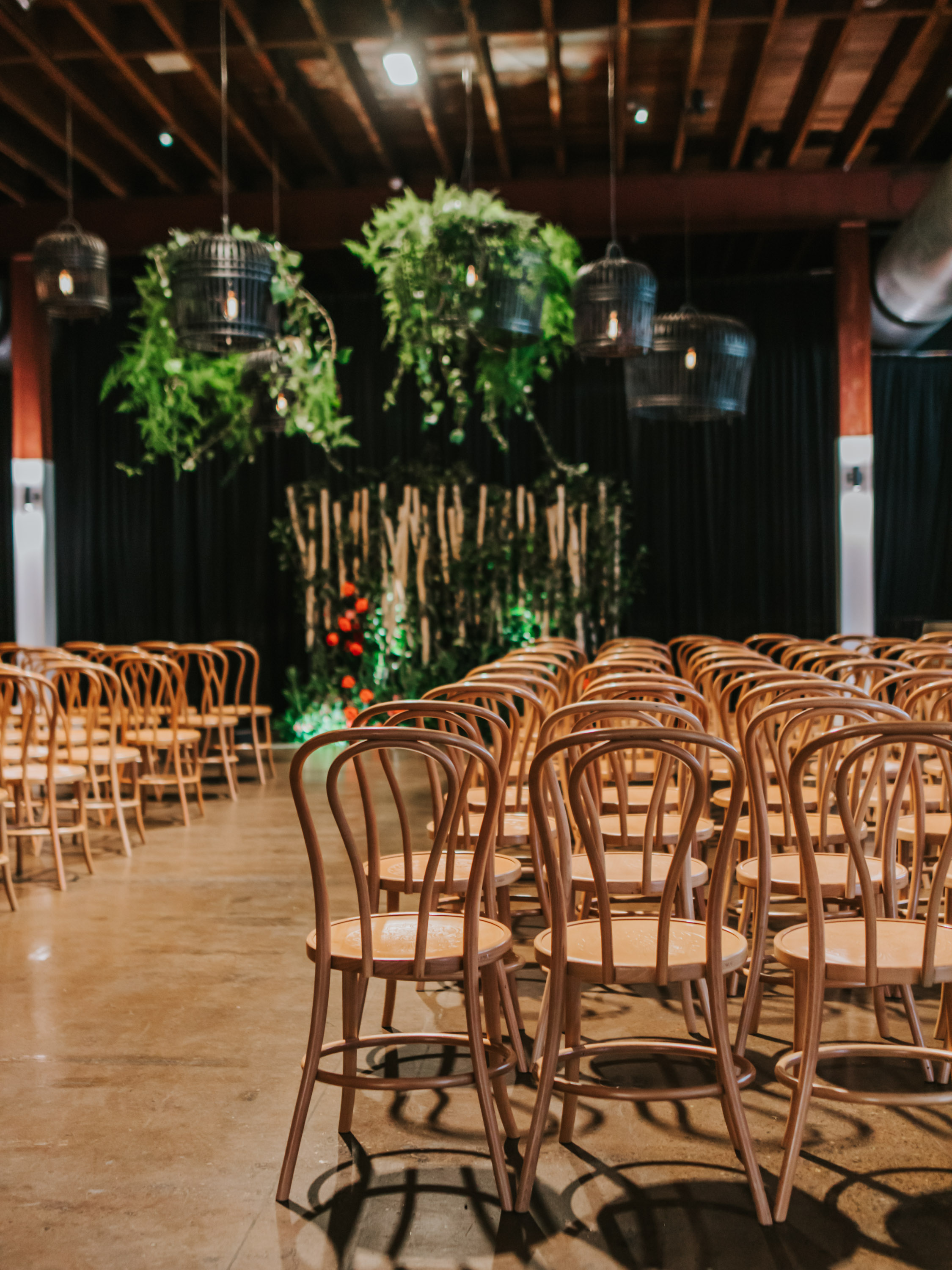 white+white weddings and events the wedding school emily and jack lightspace wedding greenery ceremony florals suspended hanging bentwood chairs