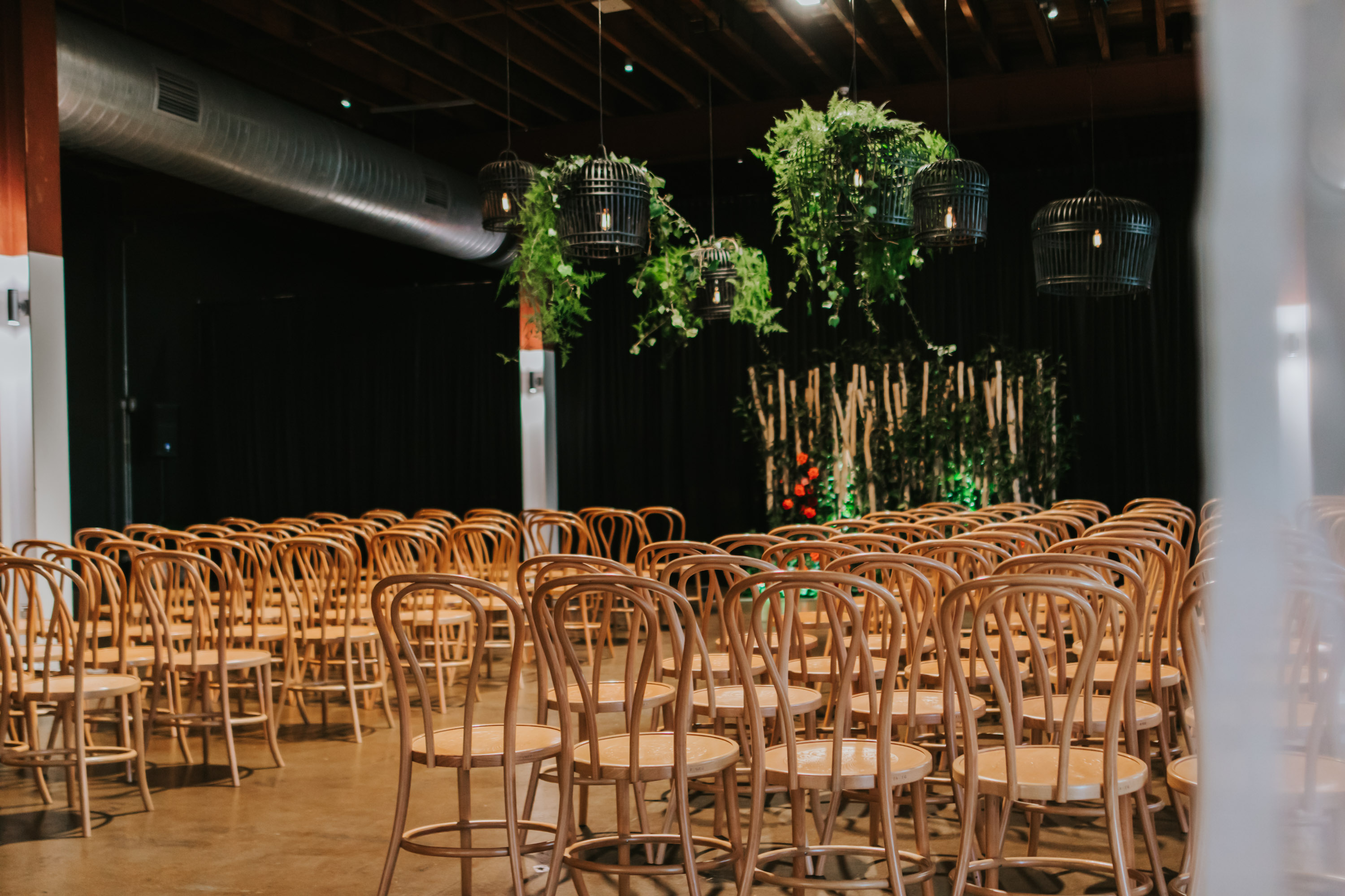 white+white weddings and events the wedding school emily and jack lightspace wedding greenery ceremony florals suspended hanging bentwood chairs venue