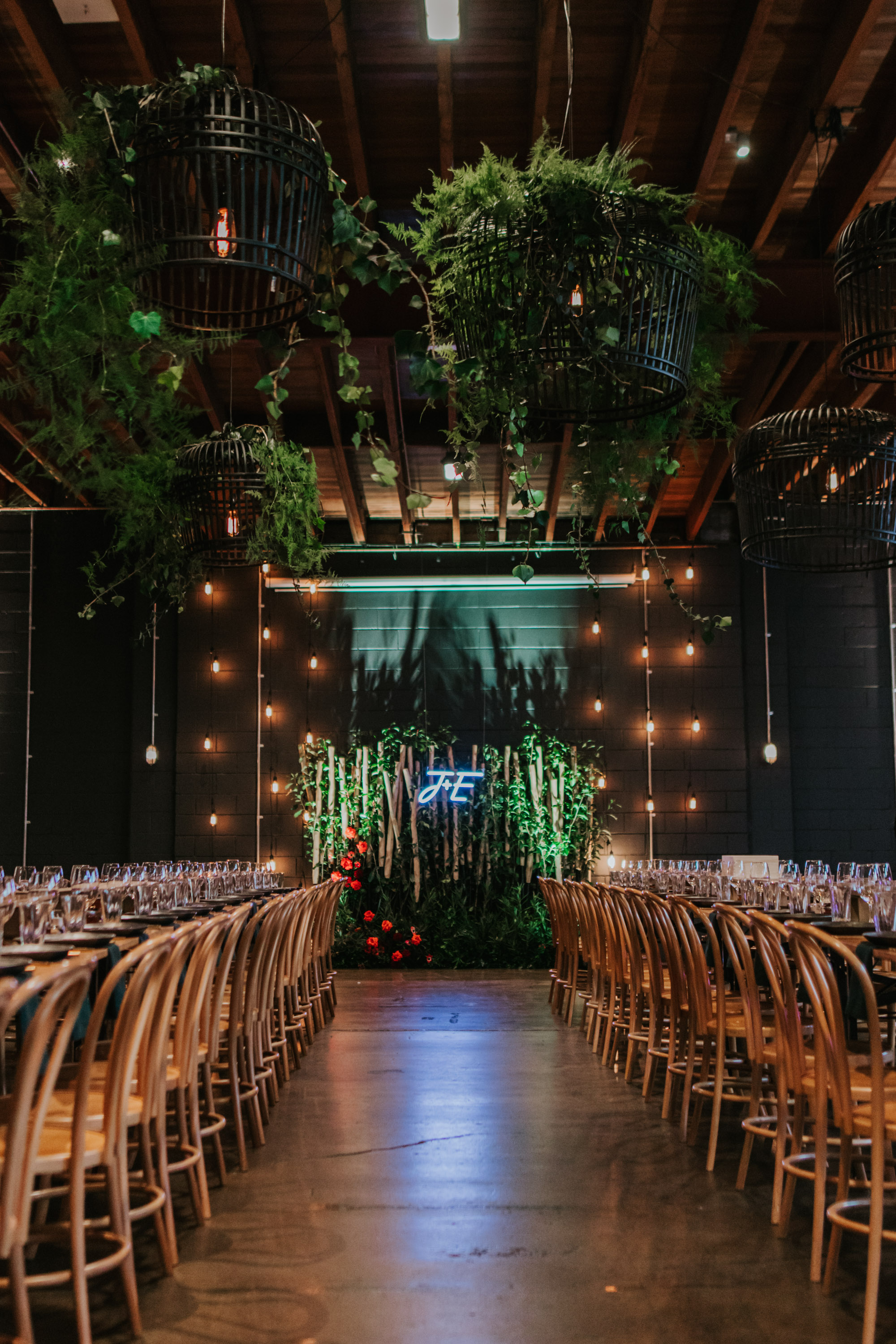 white+white weddings and events the wedding school emily and jack lightspace wedding greenery ceremony florals suspended hanging bentwood chairs asha reception table table number whole room