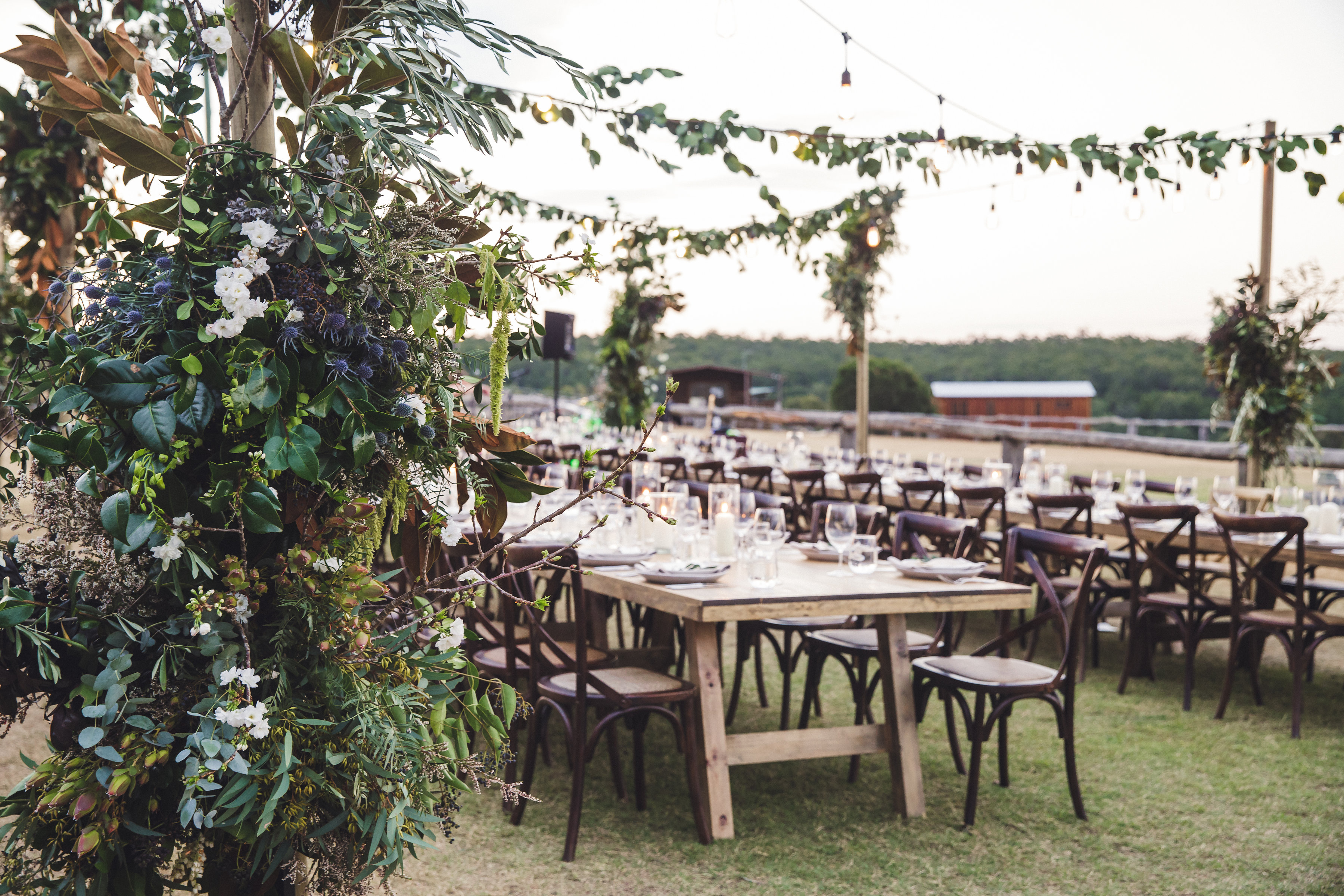 white+white weddings and events the wedding school spicers hidden vale outdoor wedding reception table setting feasting table greenery