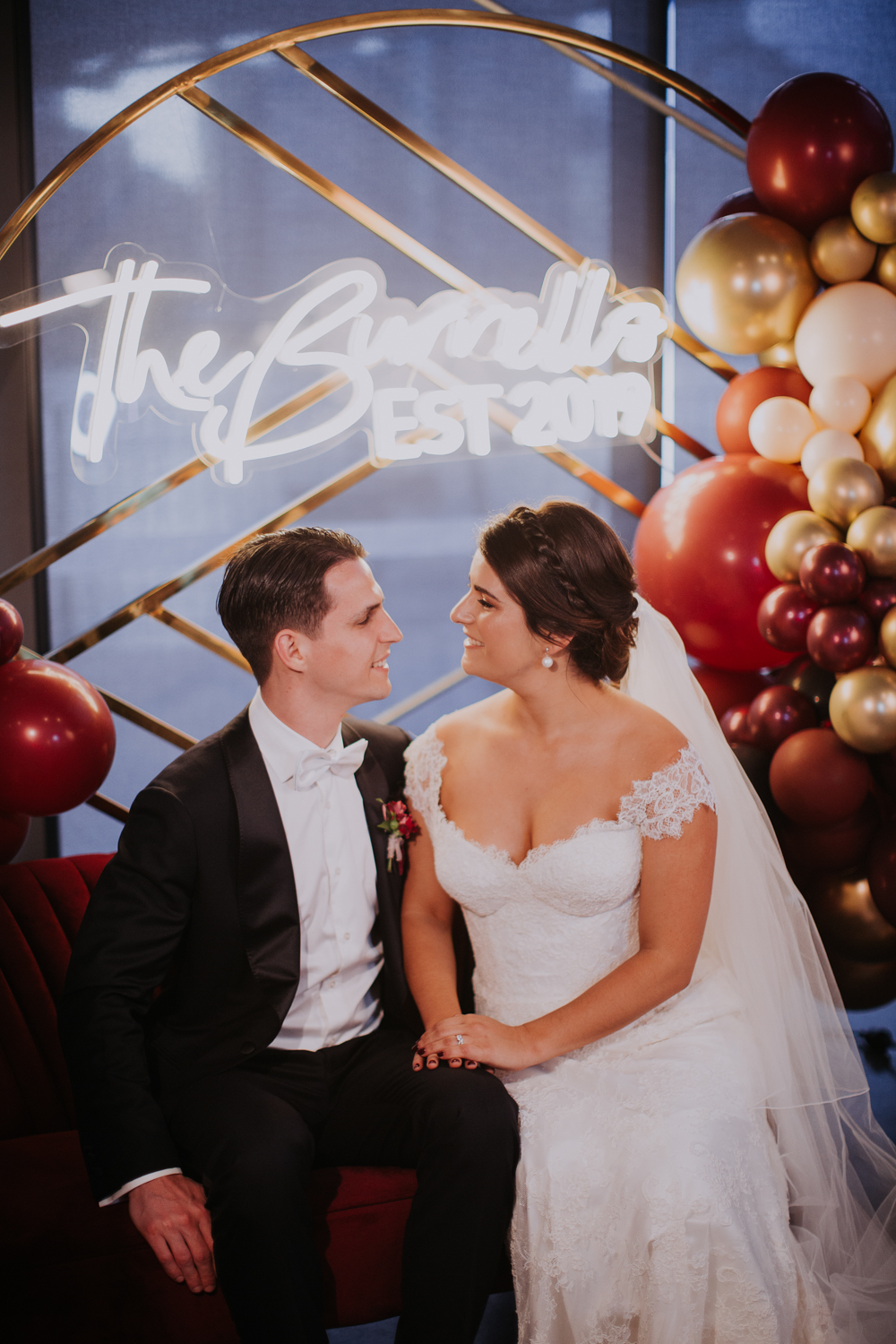 white+white weddings and events the wedding school howard smith wharves balloon backdrop neon lights