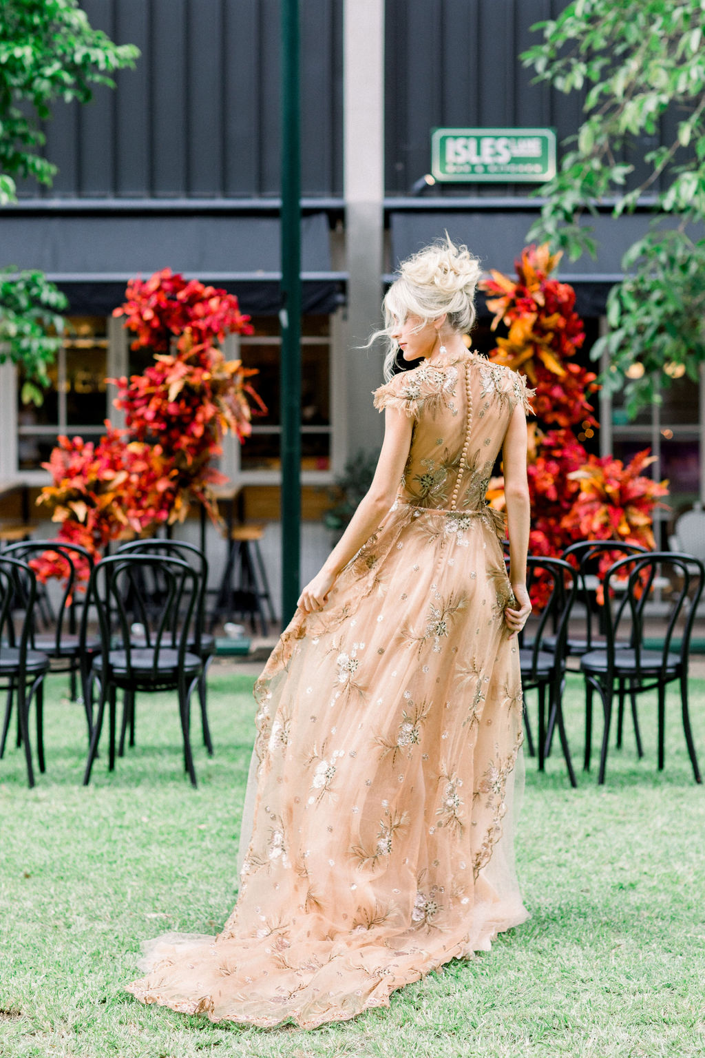 white+white weddings and events the wedding school styled shoot isles lane bride gold wedding dress outdoor ceremony bright florals
